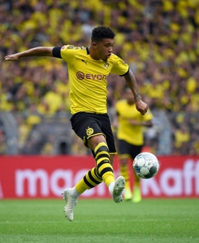 Dortmund's English midfielder Jadon Sancho kicks the ball during the German first division Bundesliga football match BVB Borussia Dortmund v Augsburg in Dortmund, western Germany, on Saturday. — AFP