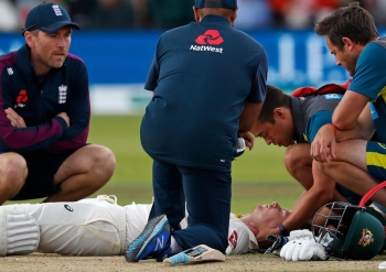 Australia's Steve Smith lays on the pitch after being hit in the head by a ball off the bowling of England's Jofra Archer (unseen) during play on the fourth day of the second Ashes cricket Test match between England and Australia at Lord's Cricket Ground in London, on Saturday. — AFP