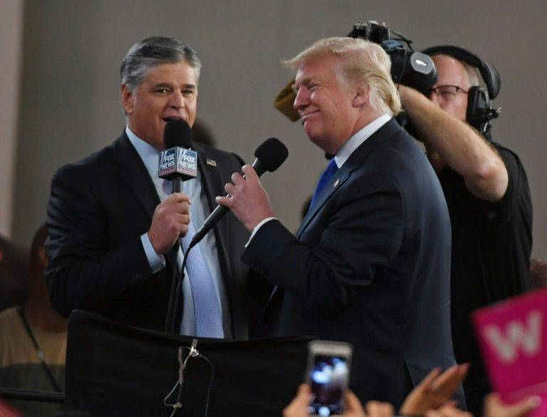 Fox News talk show host Sean Hannity (L) has been strongly supportive of Donald Trump, though the US president has grown skeptical of some others at Fox; the two men are seen here at a September 20, 2018 rally in Las Vegas, Nevada. –Courtesy photo