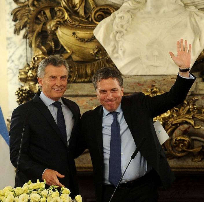 In this file photo taken in Buenos on January 10, 2017 Argentine President Mauricio Macri (L) poses with his new Finance Minister Nicolas Dujovne after swearing him in. -AFP