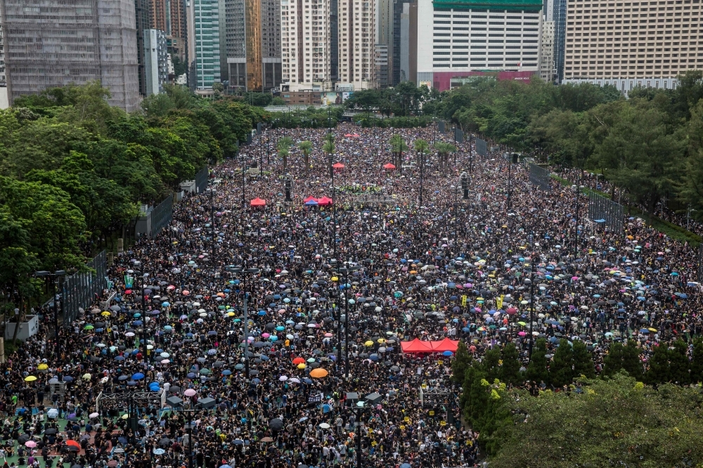 Protesters gather for a rally in Victoria Park in Hong Kong on Sunday, in the latest opposition to a planned extradition law that has since morphed into a wider call for democratic rights in the semi-autonomous city. -AFP