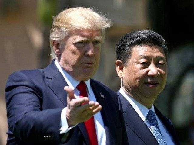 US President Donald Trump with China's President Xi Jinping. -Reuters