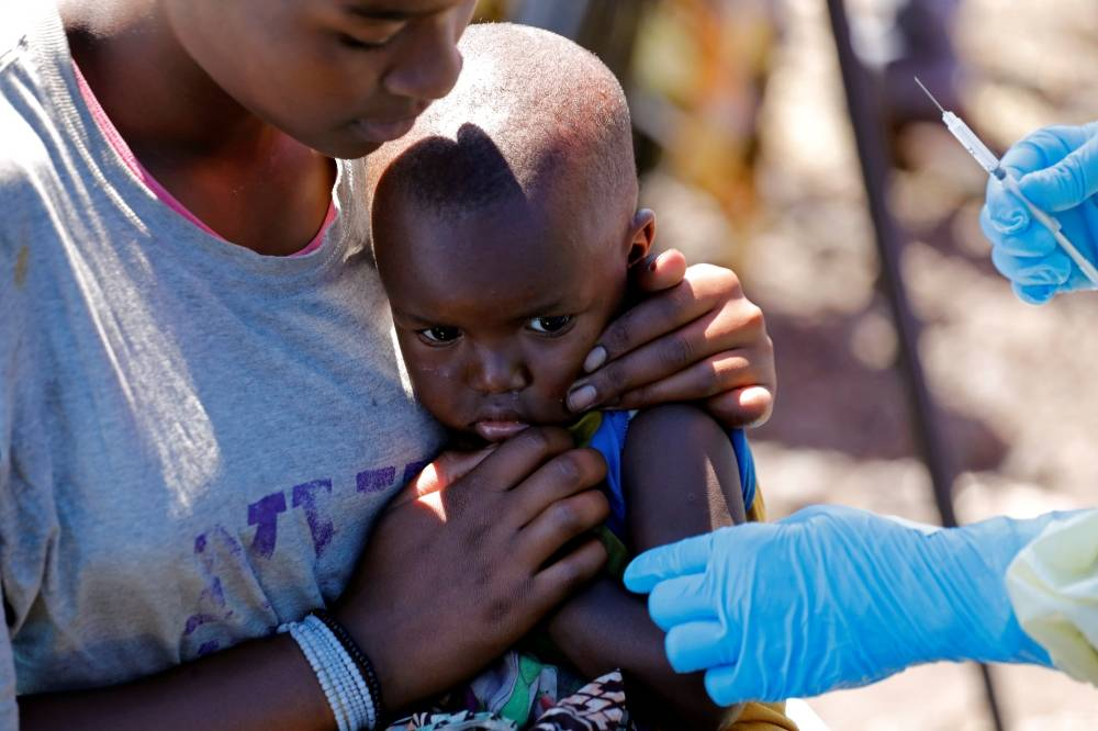 A child reacts as a health worker injects her with the Ebola vaccine, in Goma, Democratic Republic of Congo, August 5, 2019. -Reuters