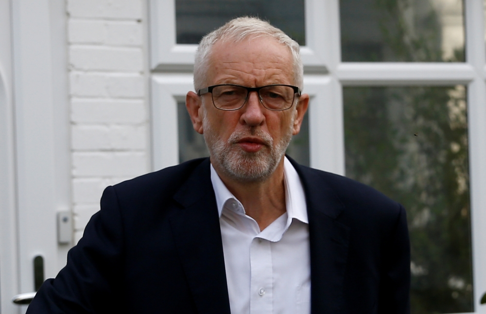 Britain's opposition Labour Party leader Jeremy Corbyn leaves his home in London on Monday. — Reuters