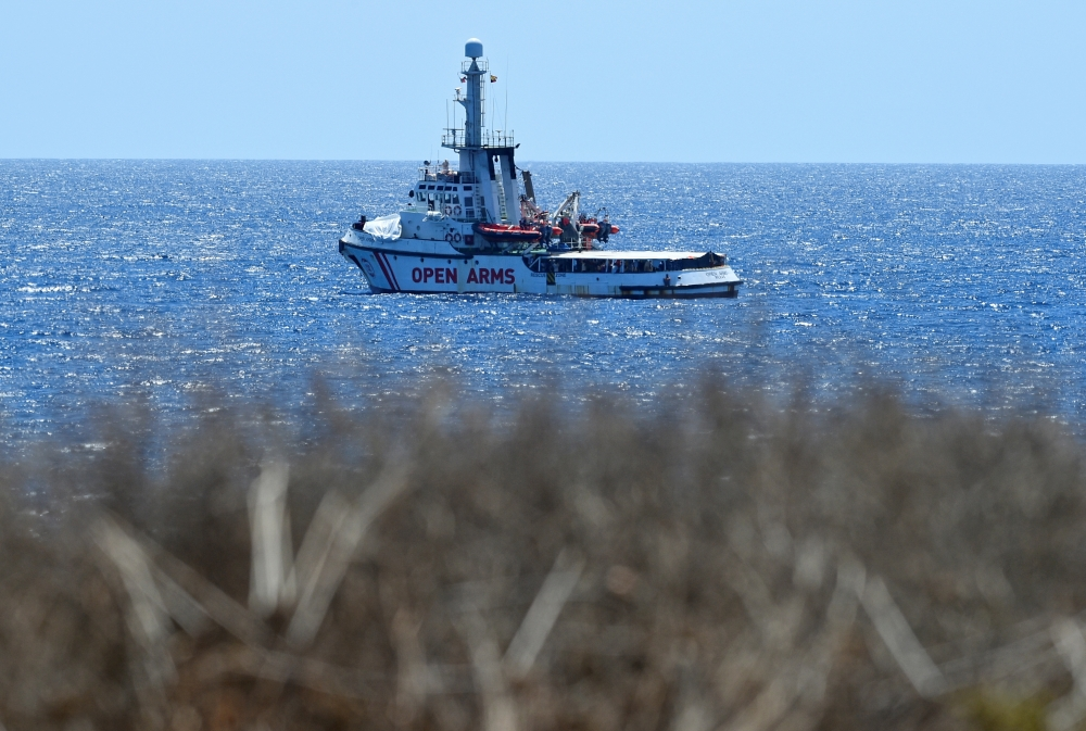 Spanish migrant rescue ship Open Arms is seen close to the Italian shore in Lampedusa, Italy, on Monday. — Reuters