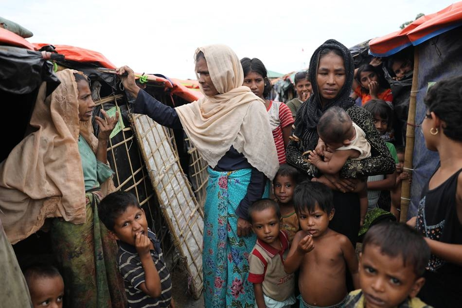 Rohingya refugee women and children gather at the Palong Khali refugee camp in Cox's Bazar, Bangladesh, in this Nov. 16, 2017 file photo. — Reuters