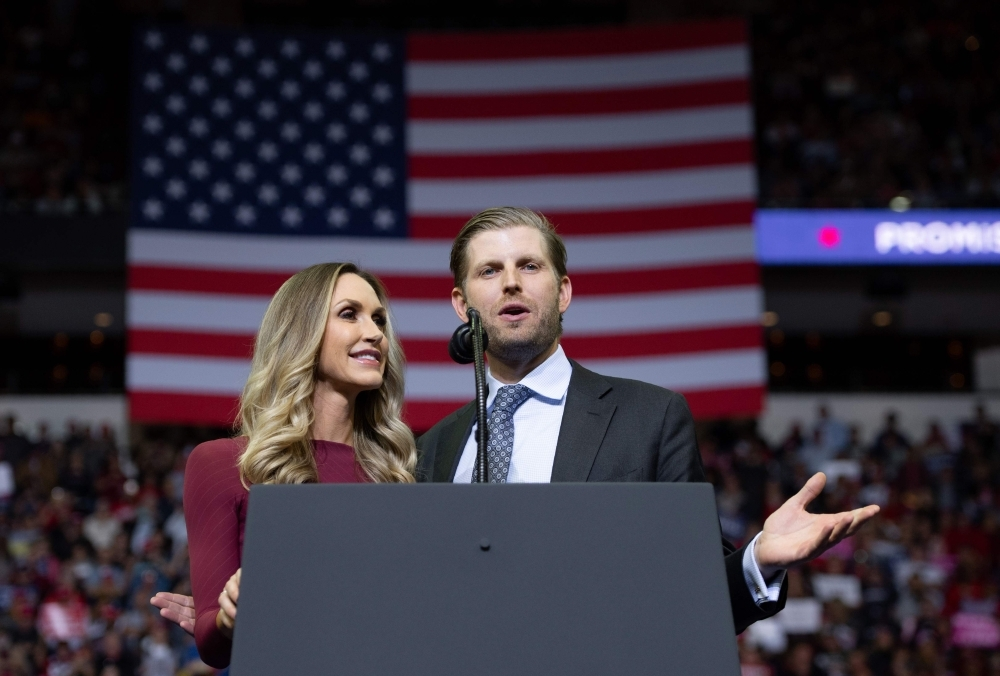 Eric and Lara Trump speak during a campaign rally hosted by US President Donald Trump at the Toyota Center in Houston, Texas, in this Oct. 22, 2018 file photo. — AFP