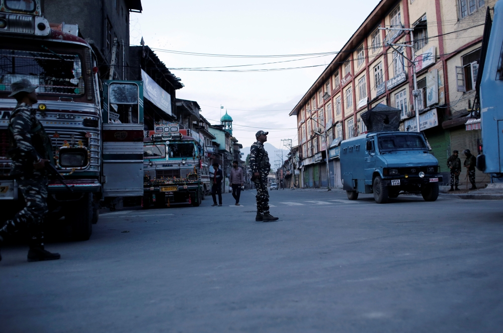 Indian security force personnel stand guard on a deserted road during restrictions after scrapping of the special constitutional status for Kashmir by the Indian government, in Srinagar, India, on Tuesday. — Reuters