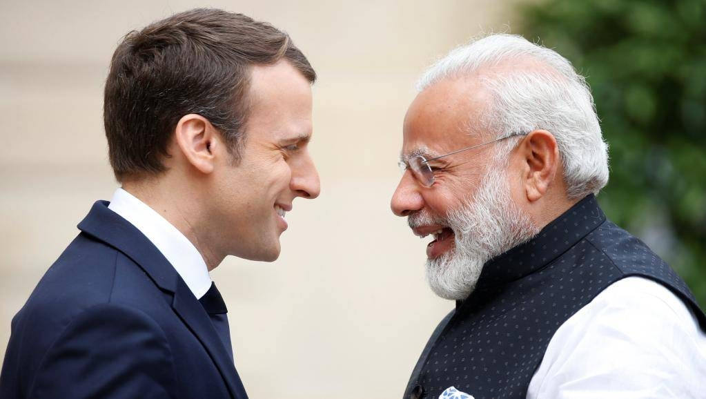 French President Emmanuel Macron greets visiting Indian Prime Minister Narendra Modi at the Elysée Palace in Paris in this file photo. — Reuters