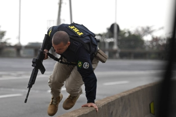 A police officer is seen near the area where a gunman who was holding a bus with 16 hostages was shot dead by police in Rio de Janeiro, Brazil, on Tuesday. — AFP
