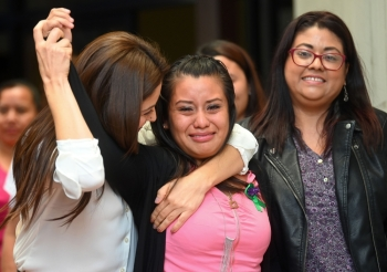 Salvadorean rape victim Evelyn Hernandez, center, celebrates with her lawyers after being cleared of murder after giving birth to a stillborn baby at home in 2016, at Ciudad Delgado's court in San Salvador, on Monday. — AFP