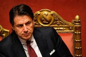 Italian Prime Minister Giuseppe Conte reacts after delivering a speech at the Italian Senate, in Rome, on Tuesday, as the country faces a political crisis. — AFP