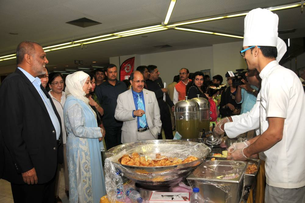 Ambassador Dr. Ausaf Sayeed and his wife at the food stall at 'India Day' event in Riyadh. — Courtesy photos