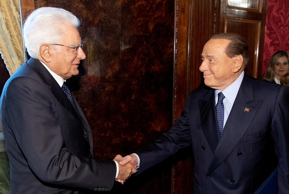 Forza Italia leader Silvio Berlusconi, right, meets with Italian President Sergio Mattarella for consultations in Rome, Italy, on Thursday. — Reuters