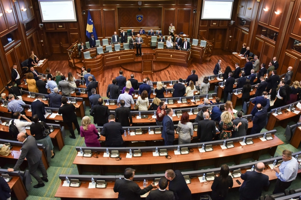 Members of the Kosovo Parliament leave after a session in Pristina on Thursday. — AFP