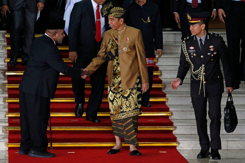 Indonesia's President Joko Widodo greets a parliament member as he departs after delivering address ahead of Independence Day at the parliament building in Jakarta, Indonesia, in this Aug.16, 2019 file photo. — Reuters