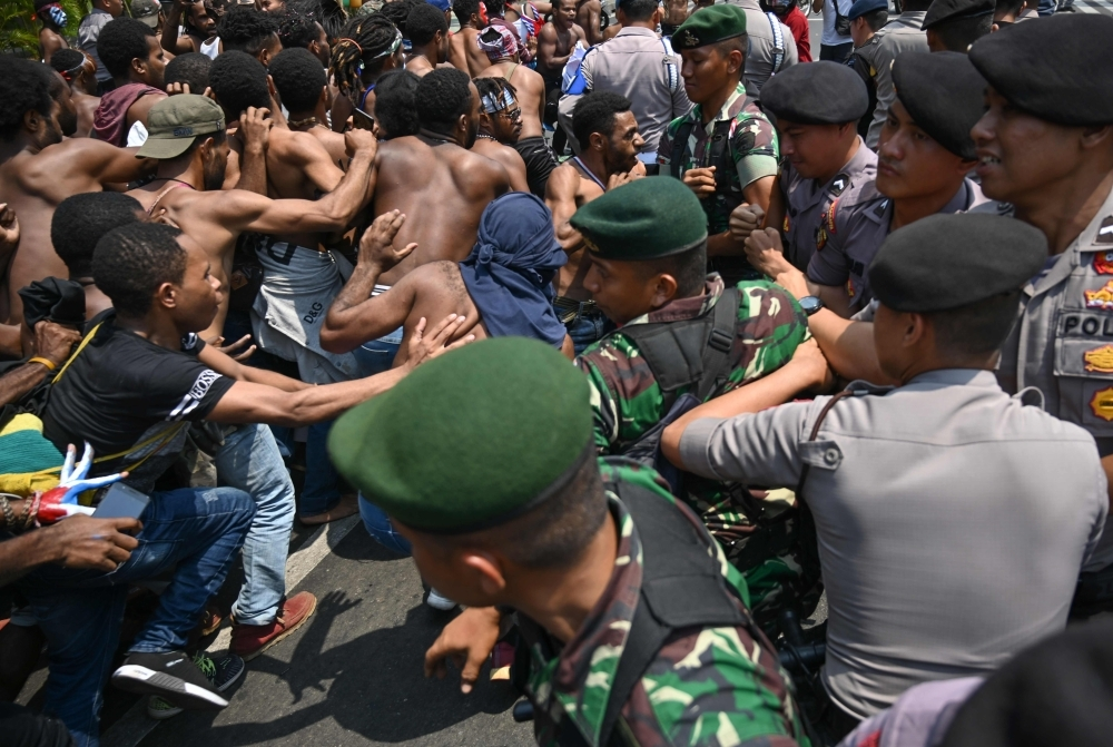 Papuan students taking part in a rally push toward a line of police and military blocking them in front of the army's headquarters in Jakarta on Thursday, as riots and demonstrations have brought several cities in Indonesia's eastern province of Papua to a standstill this week. — AFP