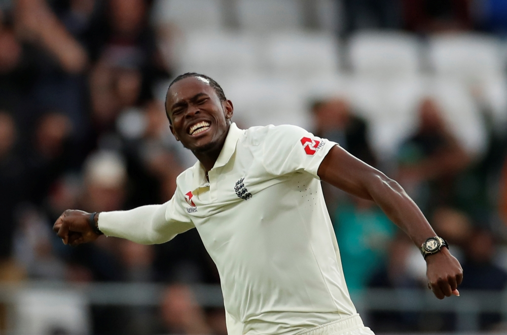 England's Jofra Archer celebrates taking the wicket of Australia's Pat Cummins during the third test match of the Ashes series against Australia at Headingley, Leeds, Britain, on Thursday. — Reuters