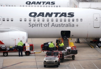 Bags are being loaded onto a Qantas plane in Melbourne, Australia, in this Oct. 31, 2011 file photo. — AFP