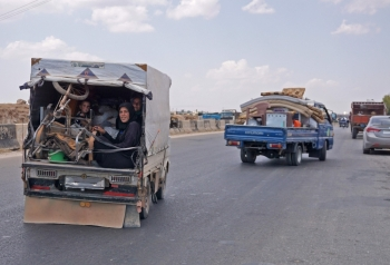 Syrians fleeing from the town of Maaret Al-Numan and its surrounding countryside drive with their belongings northwards near the town of Saraqib in the northwestern Idlib province on Thursday as they flee from the advancing Syrian government and allied forces.  — AFP