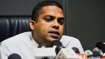 Sri Lankan Sports Minister Harin Fernando speaks during a press conference in Colombo, on Thursday. — AFP