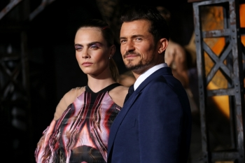 Cara Delevingne, right, and Orlando Bloom attend the LA premiere of Amazon's