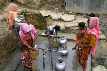 Rohingya refugees collect drinking water at the Shalbagan refugee camp in Teknaf, Bangladesh, in this March 5, 2019 file photo. — Reuters
