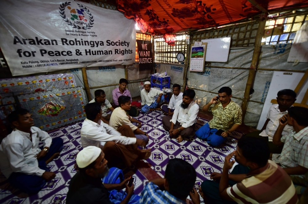 Rohingya leaders attend a meeting to plan a rally ahead of the second year anniversary of the 2017 Rohingya crisis in Kutupalong refugee camp in Ukhia, Bangladesh, on Friday. — AFP