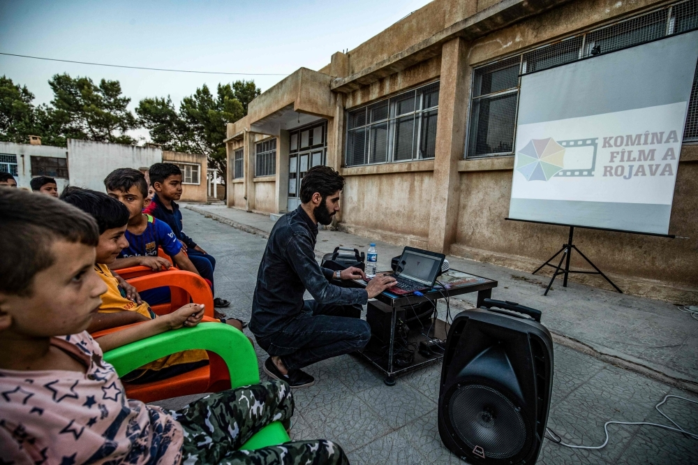 A member of Syrian-Kurdish filmmaker Shero Hinde's mobile cinema