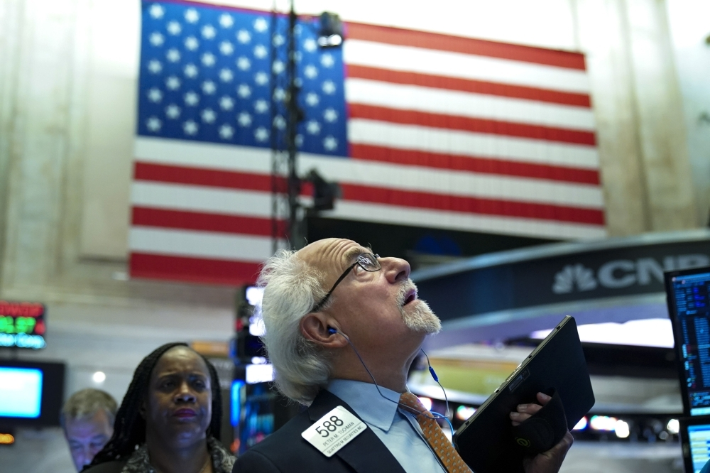 Traders and financial professionals work at the opening bell on the floor of the New York Stock Exchange in New York City in this June 3, 2019 file photo. — AFP