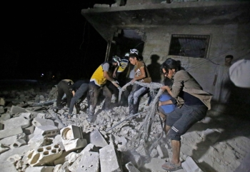 Members of the Syrian Civil Defence (White Helmets) sift through the rubble of a building following a reported government air strike in the area of Maaret Al-Numan in Syria's northwestern Idlib province on August Thursday. — AFP
