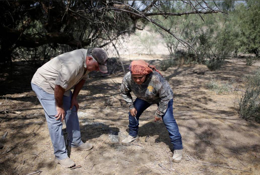 Silvia Ortiz and Oscar Sanchez, members of 'Grupo Vida', which recently opened a tortilla factory to cover the operating costs of their community-led forensic digs, take part in a search for human remains at a plot in the municipality of San Pedro, Mexico August 19, 2019. -Reuters