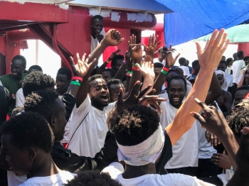 Migrants celebrate aboard the 'Ocean Viking' rescue ship, jointly operated by French NGOs SOS Mediterranee and Medecins sans Frontieres (MSF Doctors without Borders) on Friday, as six EU countries agreed to take them in after 14 days at sea. -AFP