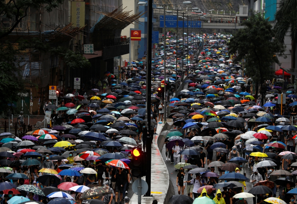 People march during a protest in Kwai Fong, in Hong Kong, on Sunday. -Reuters