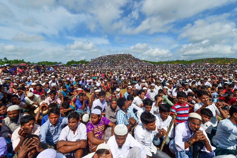 Rohingya refugees attend a ceremony organised to remember the second anniversary of a military crackdown that prompted a massive exodus of people from Myanmar to Bangladesh, at the Kutupalong refugee camp in Ukhia on Sunday. -AFP