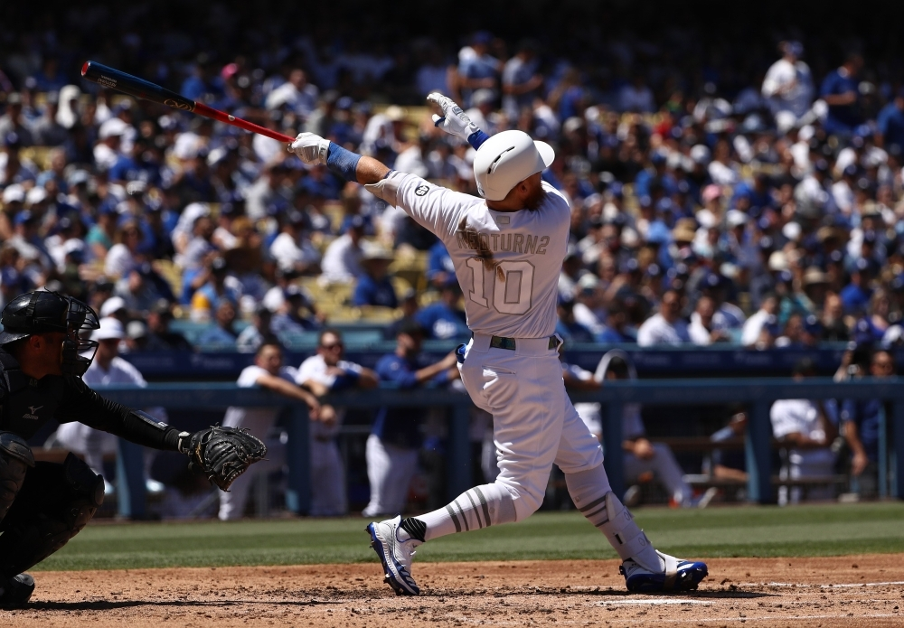 Justin Turner of the Los Angeles Dodgers hits a home run during the third inning of the MLB game against the New York Yankees at Dodger Stadium in Los Angeles, California, on Saturday. Teams are wearing special color-schemed uniforms with players choosing nicknames to display for Players' Weekend. — AFP