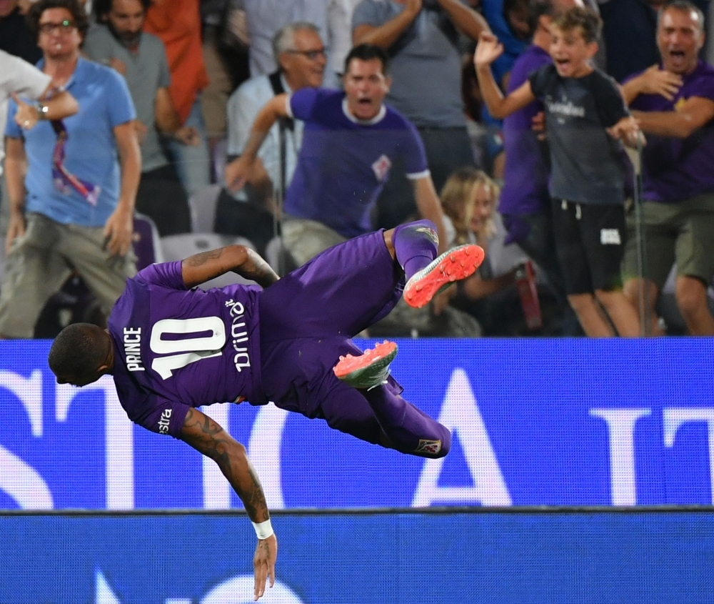 Fiorentina's Ghanaian forward Kevin-Prince Boateng performs a flip jump as he celebrates after scoring during the Italian Serie A football match Fiorentina vs Napoli at the Artemio-Franchi stadium in Florence, on Saturday. — AFP
