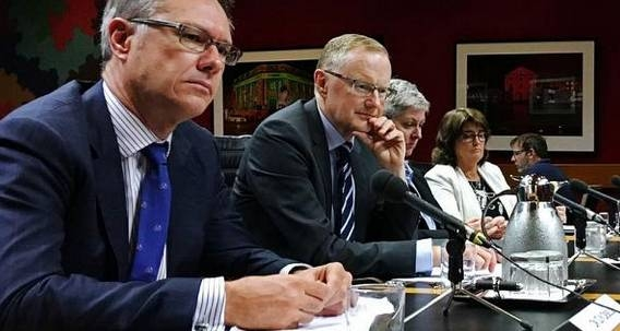 File photo of Reserve Bank of Australia Governor Philip Lowe (2nd L) as he speaks at a parliamentary committee hearing next to Deputy Governor Guy Debelle (L) in Sydney, Australia.