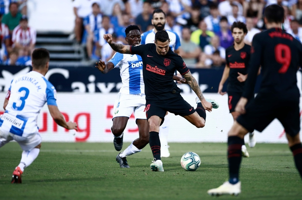 Atletico Madrid's Spanish midfielder Vitolo scores a goal during the Spanish League football match between Leganes and Atletico Madrid at the Butarque stadium in Leganes, southwest of Madrid, on Sunday. — AFP