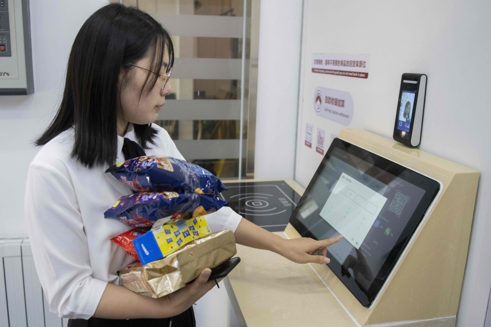 In this picture, a woman buys groceries at an IFuree Go self-service supermarket in Tianjin. China's mobile payment infrastructure is already among the most advanced in the world, but facial payment technology is bidding to make QR phone codes old-fashioned. The newest payment systems being rolled out across the country only require a person's face to make purchases — no mobile, no cash, no wallet. — AFP