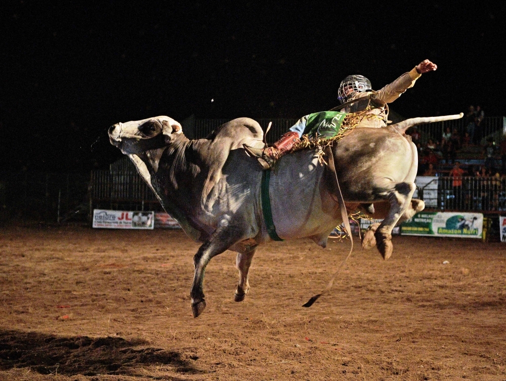 A rider competes during a rodeo event in Monte Negro, south of the Amazon basin, Rondonia state, Brazil, in this Aug. 30, 2019 file photo. In recent years, Monte Negro has expanded as a key cattle town with a strong cowboy culture. — AFP