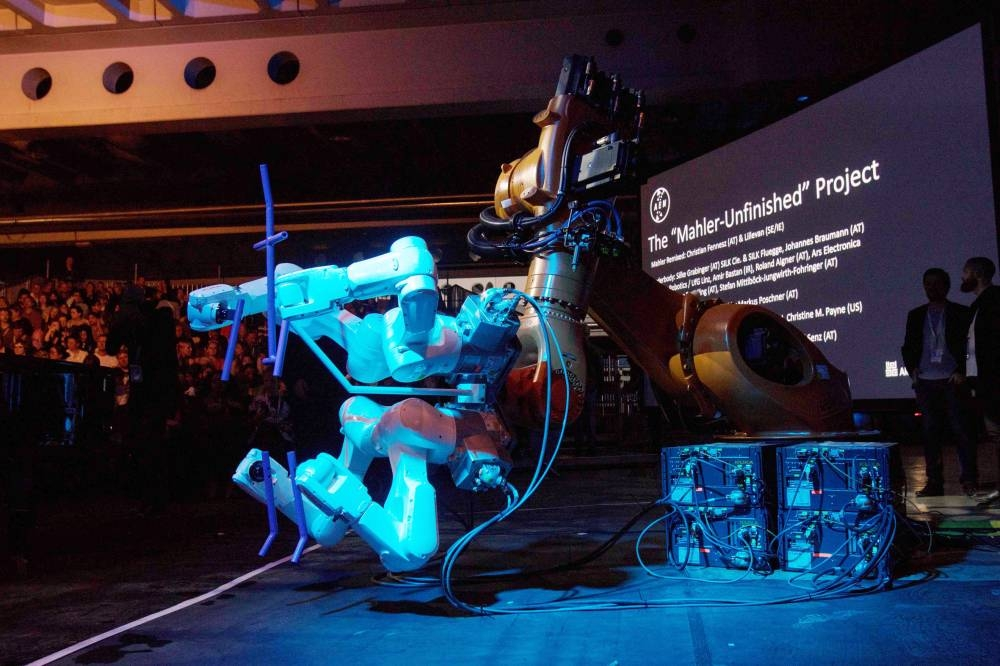 A robot stands on stage during the