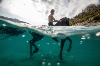 French artist Manolo trains his horse Indra to swim in the