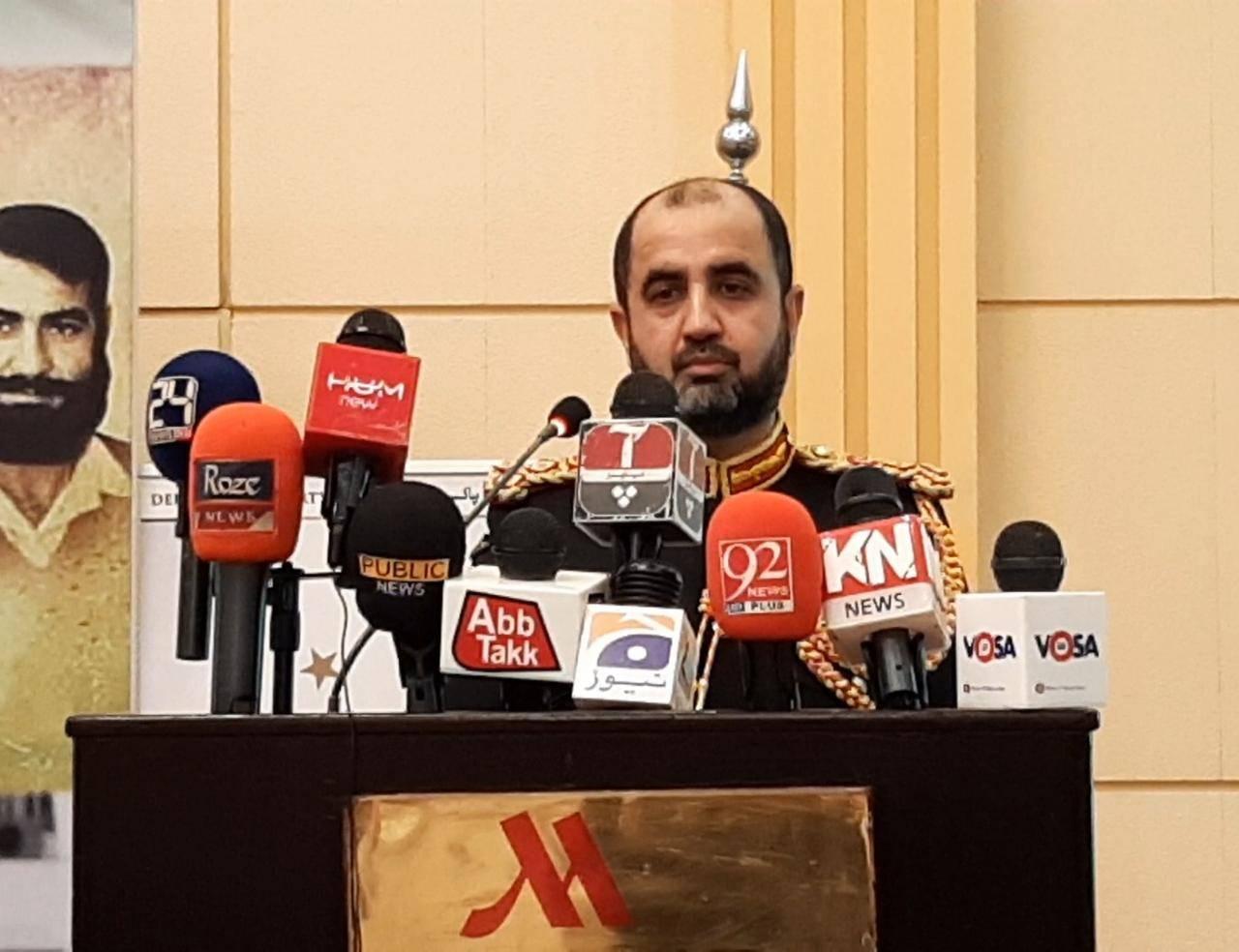 Pakistani Defense Attaché Brig. Haroon Ishaq Raja at the mike.