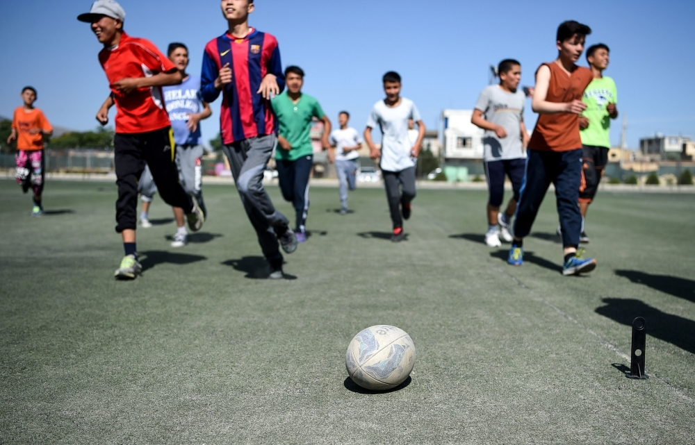 In this photo taken on June 13, 2019, young rugby players stand in line after a practice session on a pitch in Kabul. Essentially unheard of before the arrival of international forces, the sport of rugby has slowly begun to pick up steam in Afghanistan, where football, cricket and body-building are better known. — AFP