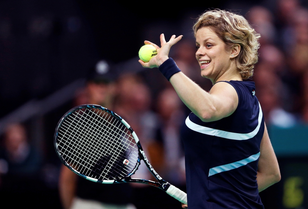 Belgium's Kim Clijsters waves to supporters during an exhibition tennis match against Venus Williams in Antwerp to mark Clijsters' retirement, Dec. 12, 2012. — Reuters
