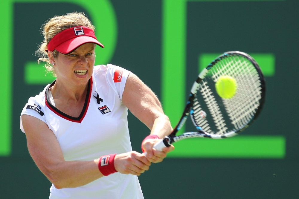 In this file photo taken on March 21, 2012 Kim Clijsters of Belgium returns the ball to Jarmila Gajdosova of Australia during Day 3 of the Sony Ericsson Open at Crandon Park Tennis Center in Key Biscayne, Florida. Clijsters will be back in competition in 2020, AFP reports on Thursday. — AFP