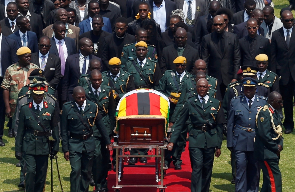The body of Zimbabwe's founder and longtime ruler Robert Mugabe is brought to the national sports stadium for a state funeral in Harare, Zimbabwe on Saturday. -Reuters