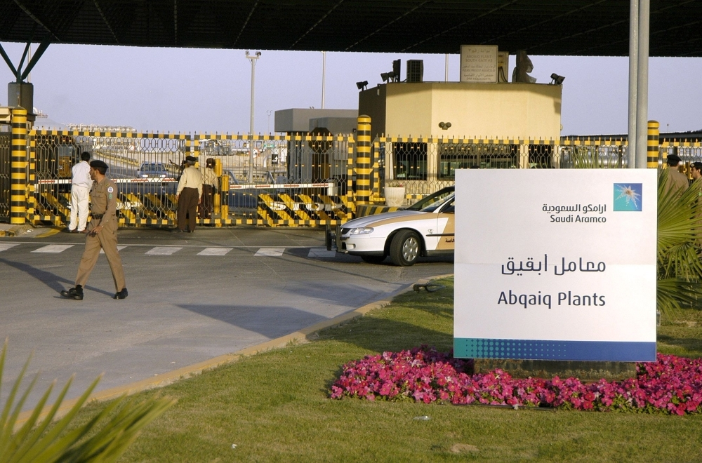 In this file photo taken on Feb. 25, 2006 Saudi security guard the entrance of the oil processing plant of the Saudi state oil giant Aramco in Abqaiq in theEastern Province. Drones struck two Saudi Aramco oil facilities early on Saturday, state media said, citing the Interior Ministry. — AFP