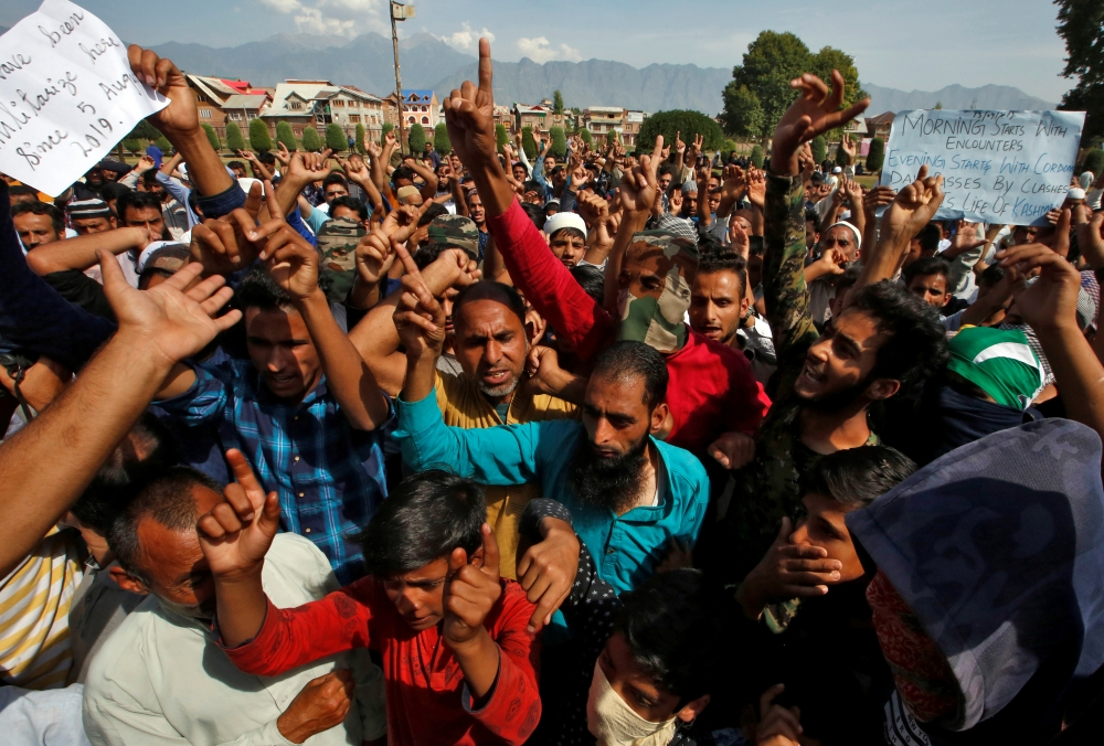 Kashmiris shout slogans at a protest site after Friday prayers during restrictions, following scrapping of the special constitutional status for Kashmir by the Indian government, in Srinagar on Friday. -Courtesy photo